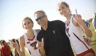 Father Sean Halloran taking a picture with his daughters Allison and Kate Halloran after their race.