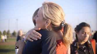 Mother Delynn Halloran hugging her daughter Kate Halloran before her race.